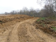 Driveway being dug up the hill