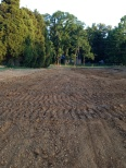 The driveway standing on the pole barn pad
