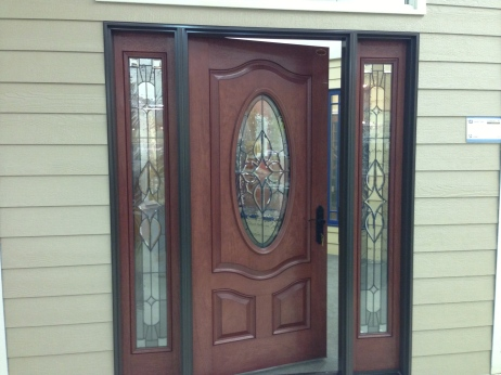 Sample of bronze trim around a mahogany stained door