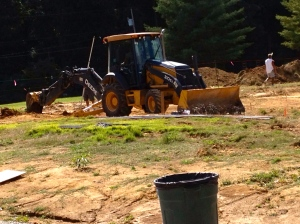 Wheeled digger with backhoe