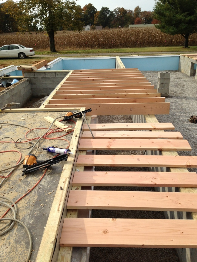 More floor joists laid out to nail