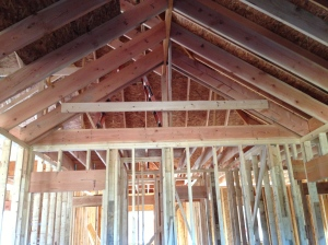 Board where the flat part of the vaulted ceiling would go in the master bedroom.