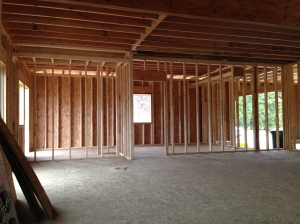 Looking from the family room toward the dining area on the left and kitchen to the right