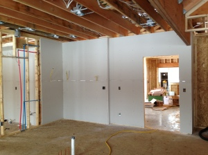 Drywall installed along the kitchen/garage wall