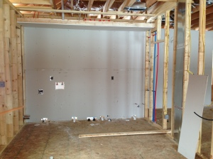 Drywall along the laundry room/garage wall