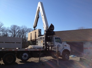 Crane picking up the drywall