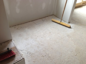 Drywall dust, excess mud, and debris