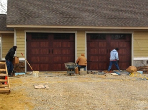 Finishing up the stone on the exterior by the garage