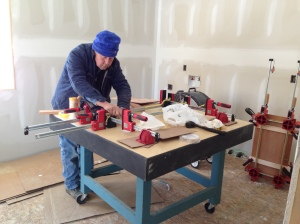 Bill gluing and clamping up cabinet doors