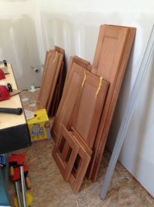 Stacks of cabinet doors all ready to be sanded and stained!