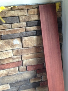 A piece of trim up against the stone of the fireplace. Matches really well.