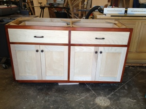Laundry room cabinet with face-frame stained and finished (doors closed)
