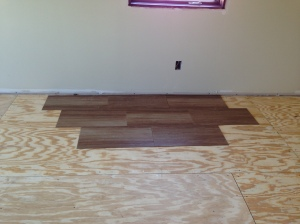 Sub-floor for the laundry room with samples of tile placement