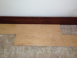 Hardwood floors next to floor boards