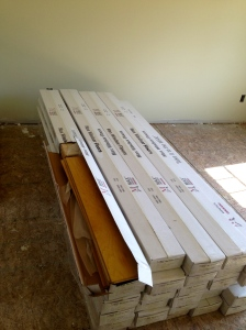Stacks of hardwood flooring in front bedroom