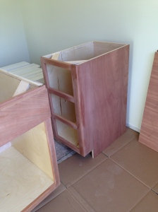 Three drawer cabinet in the island before stain