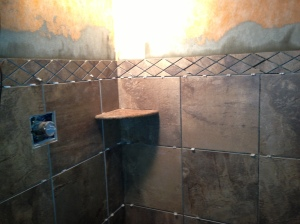 Decorative diamond shaped tile installed along with one of the corner shelves