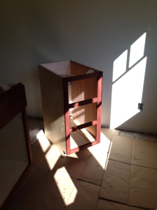 Three drawer island cabinet with stain