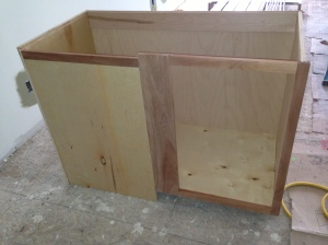 Blind corner cabinet before stain