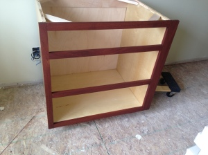 Dish drawer cabinet stained