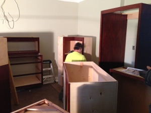 Neal checking out the first cabinet - the upper corner cabinet