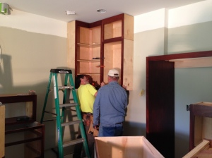 Bill helping Neal installed cabinets