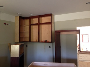 Three upper kitchen cabinets installed
