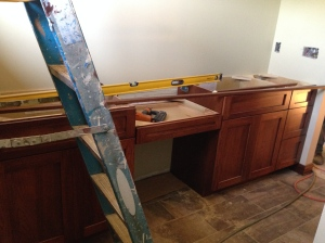Master bathroom with desk area in-between vanities