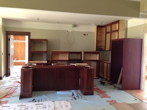 Kitchen/island cabinets lined up ready for install