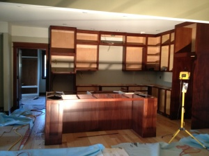 Night view of cabinets/island without doors and drawers