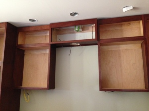 Upper cabinets above cooktop