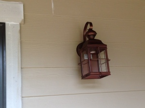 Exterior lights (front porch and on each side of garage doors)