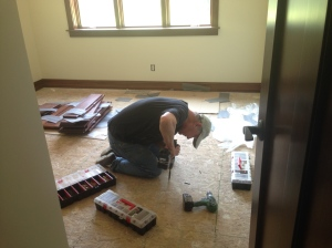 Bill trying to fix squeaks in bedroom floor