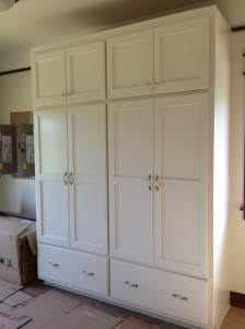 Pantry cabinet with doors and hardware installed