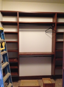 Bill's double-hanging rods on the right; Bill's shoe racks and shelves on the left