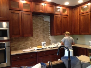 Lisa installing the backsplash tile